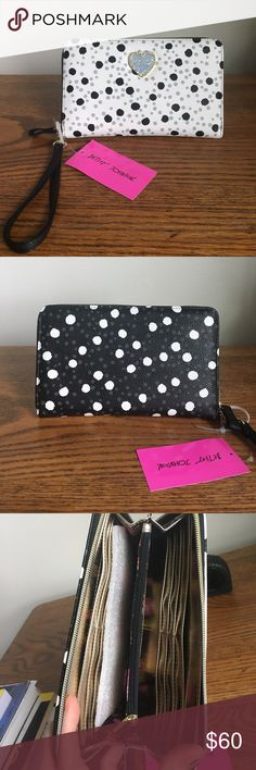 Betsey Johnson Polka Dot Wristlet Good sized wristlet, perfect for a night out! White front and black back. 12 card slots, 2 cash pockets and an inner zipper compartment for change! Even big enough to hold a check book or a cell phone! Brand new, tags still attached! Let me know if you have questions/need further pictures! Betsey Johnson Bags Clutches & Wristlets