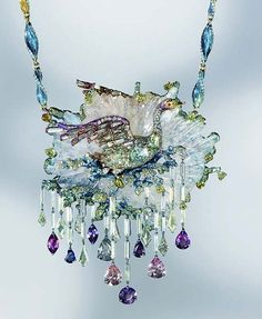 Le Cygne necklace by Wallace Chan is a mystical scene captured in a range of precious materials including fancy coloured diamonds, sapphires and crystal. The natural crystal represents the water disturbed by the swan as it spreads its wings. The swan's body is titanium in which three diamonds are embedded, and underneath three diamonds smaller diamonds are cleverly placed to enhance brilliance.