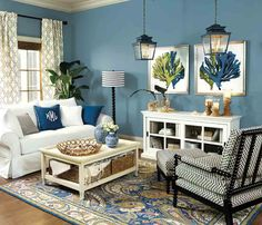 Sometimes the best thing you can do is to pick a color and run with it! That's what we did here with the bold blue wall color, which also made its way onto the rug and throw pillows!