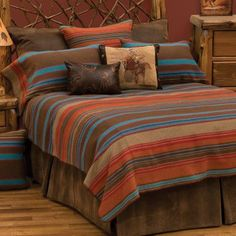 Tombstone bedspread by Wooded River offers a western ensemble full of colors of soft browns, vibrant blues, orange, gold and red stripes. The Tombstone bedspread. Rustic Bedding Sets, Western Bedding Sets, Southwestern Bedroom, Southwestern Decorating, Southwestern Style, Bed Ensemble, Wood River, Orange Bedding, White Bedding