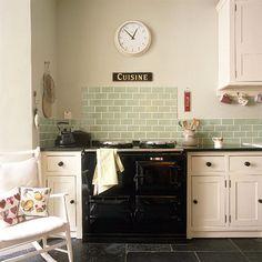 Love these green tiles with the slate flooring Green Kitchen, New Kitchen, Kitchen Decor, Black And Cream Kitchen, Cream Country Kitchen, Cream Shaker Kitchen, Slate Floor Kitchen, Country Kitchen Tiles, 1940s Kitchen