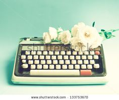 Typewriter and roses by Andrekart Photography, via Shutterstock