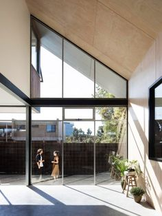 Second Floor Of This Australian House Is Hidden Beneath A Large Pitched  Roof Roof Architecture,