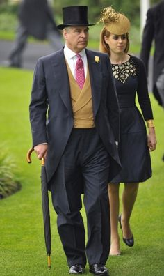 Royal Ascot - Prince Andrew is wearing a black silk plush top hat that fits perfectly. His morning wear ensemble with pink micropattern tie, stick pin & buff waistcoat looks great on him. Note the wide button stance of the 6×2 waistcoat with cloth covered buttons & how the watch chain suits him & his figure perfectly. The shoes look great & it is difficult to say whether they are actually patent leather oxfords or simply spit-polished.