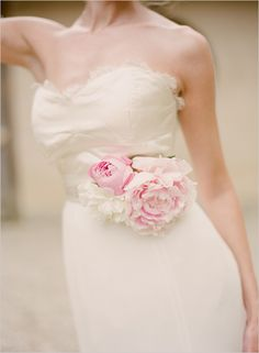 Floral wedding sash to accessorize your gown. Floral Design: Birch Blooms http://www.weddingchicks.com/2014/05/27/wearable-floral-art/