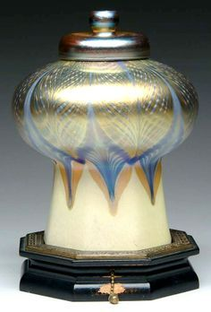 An Outstanding Tiffany Favrile mosque lamp featuring a decorated shade with gold iridescent pulled feather design  Favrile Glass was invented by Arthur Nash and Emglishman who had worked a Webb & Co.  Nash was an accredited UK Glass Chemist and a Master Glass Blower