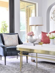 Bright and beautiful living room styled for spring. Great step by step basics to help you make seasonal changes in your decor.