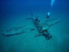A diver explores the wreckage of a Japanese World War II fighter plane near the town of Rabaul in Papua New Guinea.     Repin & Like - If you think its an it's an excellent photo and an incredible dive!