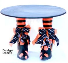How cute is this cake stand.  Thrift store boots spray painted and Plastic cups for legs!! Fun!!   ——-Im not sure Id want someones nasty shoes on my counter, displaying my food. But the idea is cute. Id find a way to craft a pair of fake shoes.
