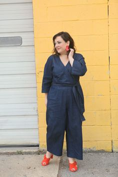 Wardrobe Oxygen in a denim wrap style jumpsuit from ELOQUII with orange suede Ann Taylor heeled sandals and red lucite statement earrings Jumpsuit Outfit, Denim Jumpsuit, Trousers, Petite Fashion, Plus Size Fashion, 50 Fashion, Mode Orange, Plus Size Workwear, Orange Fashion