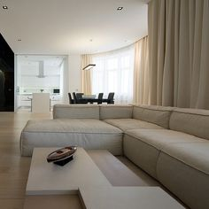 Astounding Family Room Design Kamenschiki Apartment Ivan Selvinsky White Colored Sectional Sofa And White Low Table
