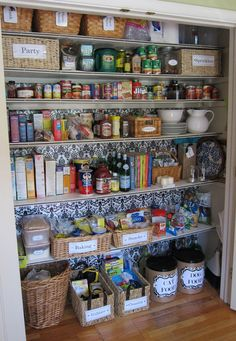 Laundry room closet, detailing on shelves, wallpaper, store plastic bags in mail tubes, many great ideas here.