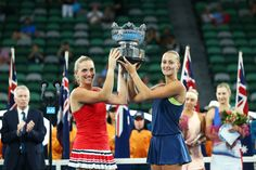 Timea Babos (L) of Hungary and Kristina Mladenovic of France pose for a photo with the championship trophy after winning the women's doubles final against Ekaterina Makarova of Russia and Elena Vesnina of Russia on day 12 of the 2018 Australian Open at Melbourne Park on January 26, 2018 in Melbourne, Australia