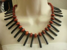Black Bamboo Stick and Coral Ruby Beaded Necklace by NickyeCole, $50.00