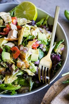 Guacamole greens salad with cilantro lime jalapeño vinaigrette, inspired by Sweetgreen's signature salad. Filled with chicken, fresh avocado, red onion, and crispy tortilla chips!