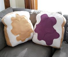 Too cute. Peanut butter and jelly sandwich throw pillows. May be able to make these myself too...