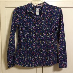 Lovely Navy Floral Print Button Down Top Double pockets on front. Looks great with skinny jeans with sleeves rolled up. Well loved and cared for with price accounting wear. 20% off bundles! Thanks for looking! Tops Button Down Shirts
