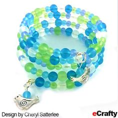 eCrafty.com Memory Wire, along with two of our sea glass bead blends and a few of our bird charms make this beaded cuff bracelet. Memory wire is a very each material to work with for crafters of all skill levels – great for beginners! #seaglass #beachglass #diybracelet #diyjewelry #diycdrafts #memorywire #crafts #beads, #jewelry #diyjewelry #jewelry #bracelet #beading #charmbracelet #ecrafty #bird #birdcharms www.eCrafty.com
