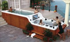 The world's coolest hot tub? The two-tiered jacuzzi which comes with its own bar, flat-screen TV and inbuilt sound-system