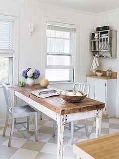modern metal chairs & vintage galvanized plate rack are paired with a rustic farmhouse table