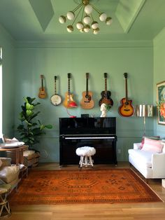 Hang Pete's guitars all together in one place like this. Over fireplace??