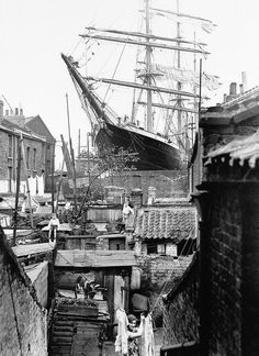 "A sailing ship in dry dock Millwall, East London 1932 [[MORE]] Some info on the ship, if you're interested: "" The S.V. Penang was a three-masted steel barque built in 1905 in Germany, and was originally named the ""Albert Rickmers"". In 1910 she was..."