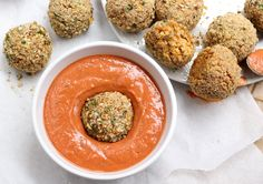 Baked Italian Rice Balls (Arancini) with a Creamy Marinara Dipping Sauce. Soft, cheesy & risotto-filled centered PLUS a crisp, herby + breaded exterior.