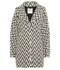 """The best part of summer's departure is dressing for the falling temperatures. This print has been seen everywhere with its bold print on jackets, also accented with fur. This """"chevron print"""" has been seen everywhere from jackets to t-shirts and also in accessories. Www.elle.com/fashion/trend reports  Christina P."""