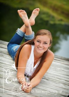 Senior pictures with a casual outfit, on a dock by the water