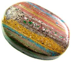 Rainbow Calsilica stone - Calsilica... Mysterious Wonder Stone or Man-Made Rainbow?  Ever since Calsilica was introduced to the international jewellery scene back in 2002, fashion gurus and jewellery artists alike have debated the origins and authenticy of Calsilica.  Some samples contained pulverized carbonate rock mixed with pigments and stabilized with a polymer.  The debate goes on.