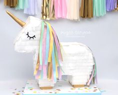 Unicorn piñata cake! by Sugar Canvas