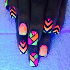 Bold colors and lines are combined to create this amazing looking tribal nail art design. Play with diagonals and stripes over a set of matte and gradient neon base polish.: