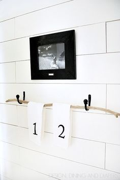 Vintage Modern Half Bath Makeover - this driftwood towel holder is really different and brings a lot of character to the space. via designdininganddiapers.com