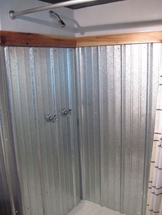 galvanized metal – it is rust proof! This shower surround is industrial and modern and was done by Catherine and Jarrett from Bungalow Bungahigh. This was actually done in their basement bathroom – I bet all that shiny metal really did help to brighten it up in there.