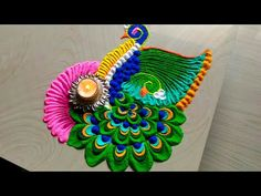 Easy & beautiful Peacock rangoli using spoon - YouTube