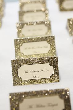 Glittery place cards add an extra bit of shine to your day. #weddingdecor