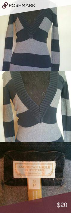 American Eagle striped long v-neck sweater Gray & navy stripes. Long sweater, hits on the upper thigh. Deep v-neck. American Eagle Outfitters Sweaters V-Necks