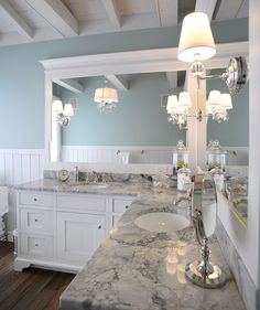 Master bath - Nice color combo .... I like the granite (super white???) with white cabinets (these are too modern), light fixtures & paint color    Not sure if I like the hardwood floors or not.