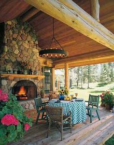 What a beautiful front porch ... :)        special thanks Alpine Log Homes  http://www.loghome.com/alpine-log-homes-glacier-view