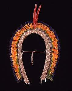 Headdress with blue, orange, and green feathers  | Please  contact the Penn Museum archives for permission to re-distribute these images.