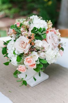 Ivory green pink peach floral centerpiece (Photo by Annabella Charles Phtography)