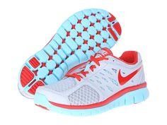red & aqua running shoes Nike
