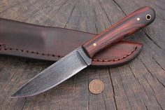 The classic Frontier Trapper model is enhanced with a deluxe ironwood handle! Oh yes. O-1 high carbon steel. Overall length 8 1/4 inches; blade is 4 inches. An ideal, all-around carry knife with fantastic character to go along with it. Comes with the pictured handmade leather (vertical-carry) sheath! A pair that should serve you for years to comes! $170, plus shipping! Questions? lucas@customhuntingknives.org is the one to answer them! Thank you for your support!
