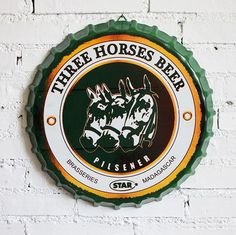 Bottle Cap Metal Sign is Non-Glare, Colorfast, Non-Fading, and Waterproof Size: diameter 2 Holes at Top Crease For Easy Hanging Bottle Cap Shape Made f Madagascar, Beer Mats, Beer Bottle Caps, Beer Coasters, Metal Signs, Beer Labels, Horses, Trays, Bottles