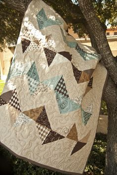 "Boy zigzag quilt using ""Pure"" by Sweetwater for Moda. The quilt on the end of my couch. We love it. Thanks Vanessa!"