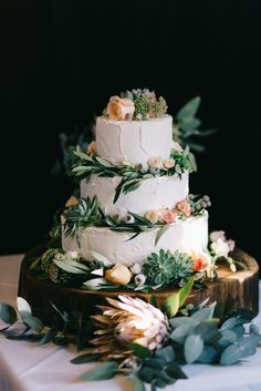 A three tier flourless chocolate cake with a mix of succulents, roses and natives, tying in with the bouquets and other floral decorations at the venue. The cake was placed on a huge elm log board which will be used as the ultimate cheese board!