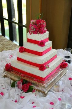 Gorgeous 4 tiered square wedding cake with ribbon and beading and fresh flowers!
