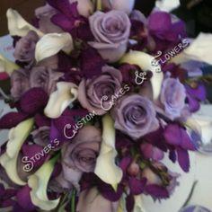 Brides bouquet cascade flowers white ivory purple lavender lapis lilac roses orchids calla lilies Lilly wedding flowers