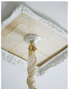 I fun frame, some music paper tea stained and BAM! you have a gorgeous ceiling medallion for your chandie.