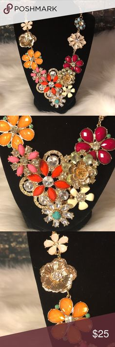 Statement floral necklace gold and enameled NWT This piece is beautiful on and has so many different colors. Gold and enamel flowers with crystals and rhinestone. Additional 3 inch drop to add any needed length. Merona Jewelry Necklaces